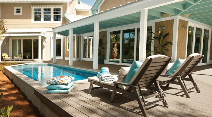 Trex Transcend decking in Gravel Path surrounds this smart home pool in Florida.
