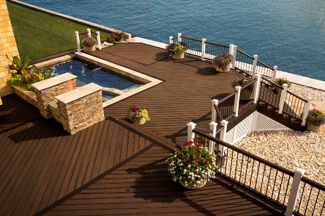 Trex Transcend Spiced Rum decking and Transcend railing make a powerful statement of beauty and durability at this coastal home.